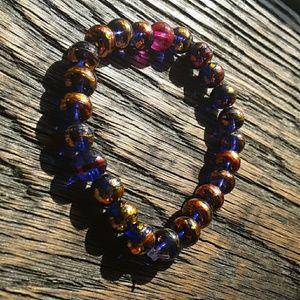 Colorful gold crackled handmade beaded bracelet.